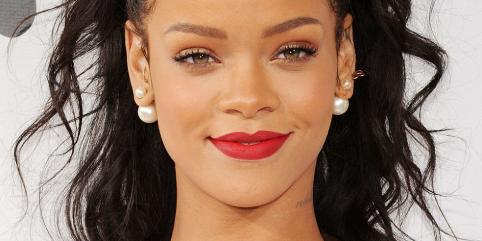 Rihanna Shows Off Red Pout During Photo Shoot