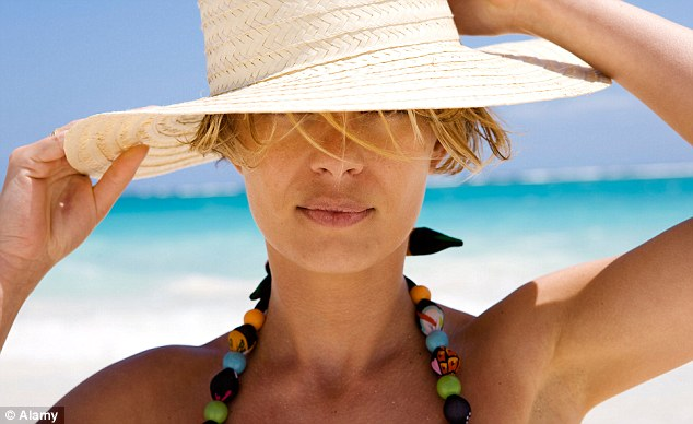 3 Ways To Stop Frizzy Beach Hair In Its Tracks